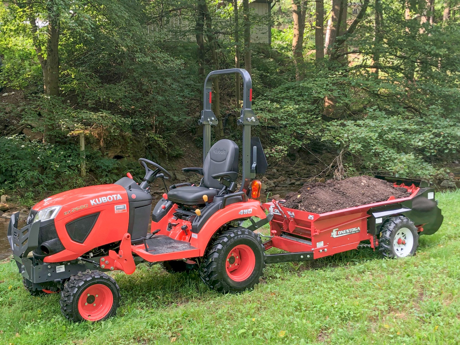 ground driven manure spreader pulled by kubota compact tractor