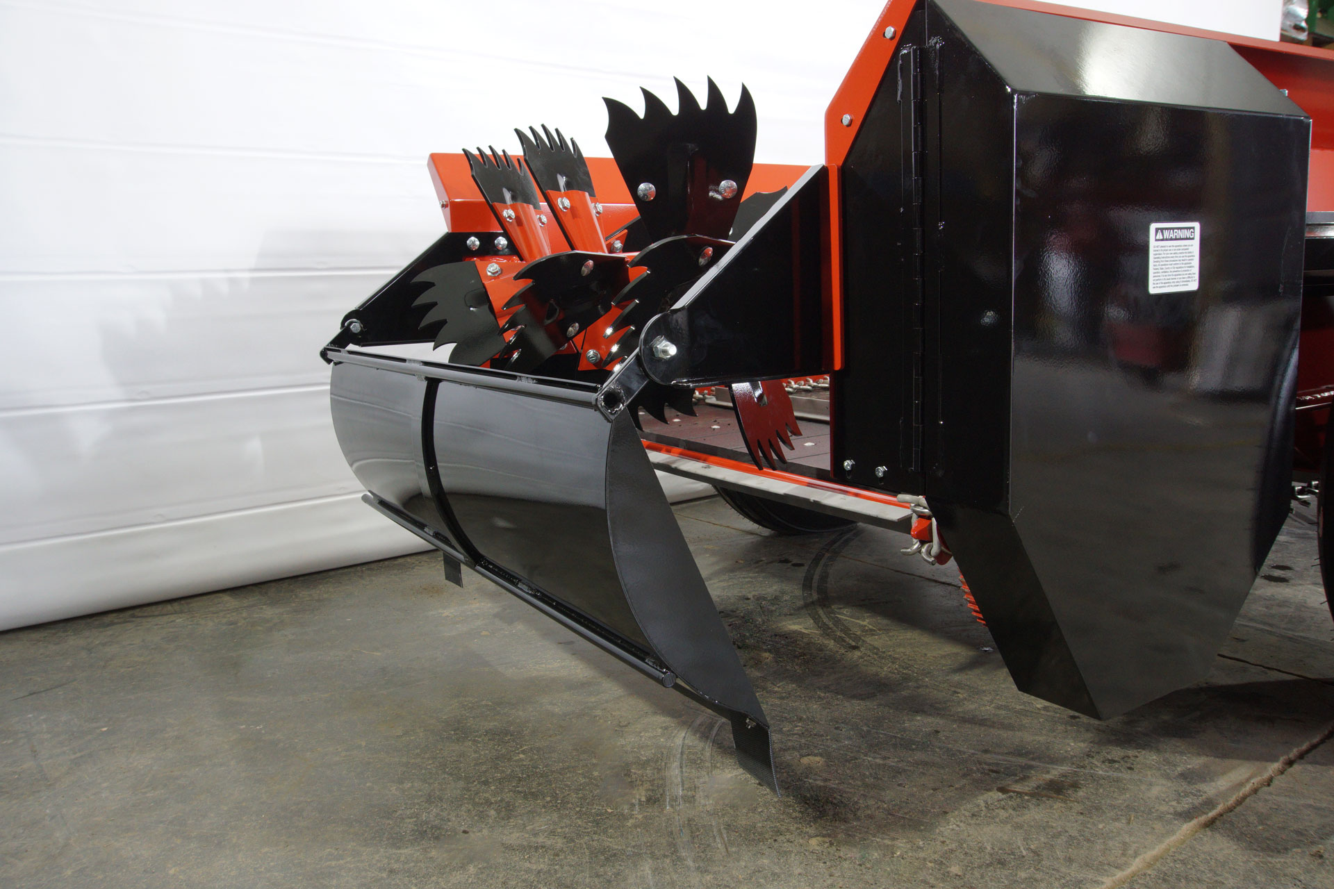 PTO farm manure spreader with fines pan.