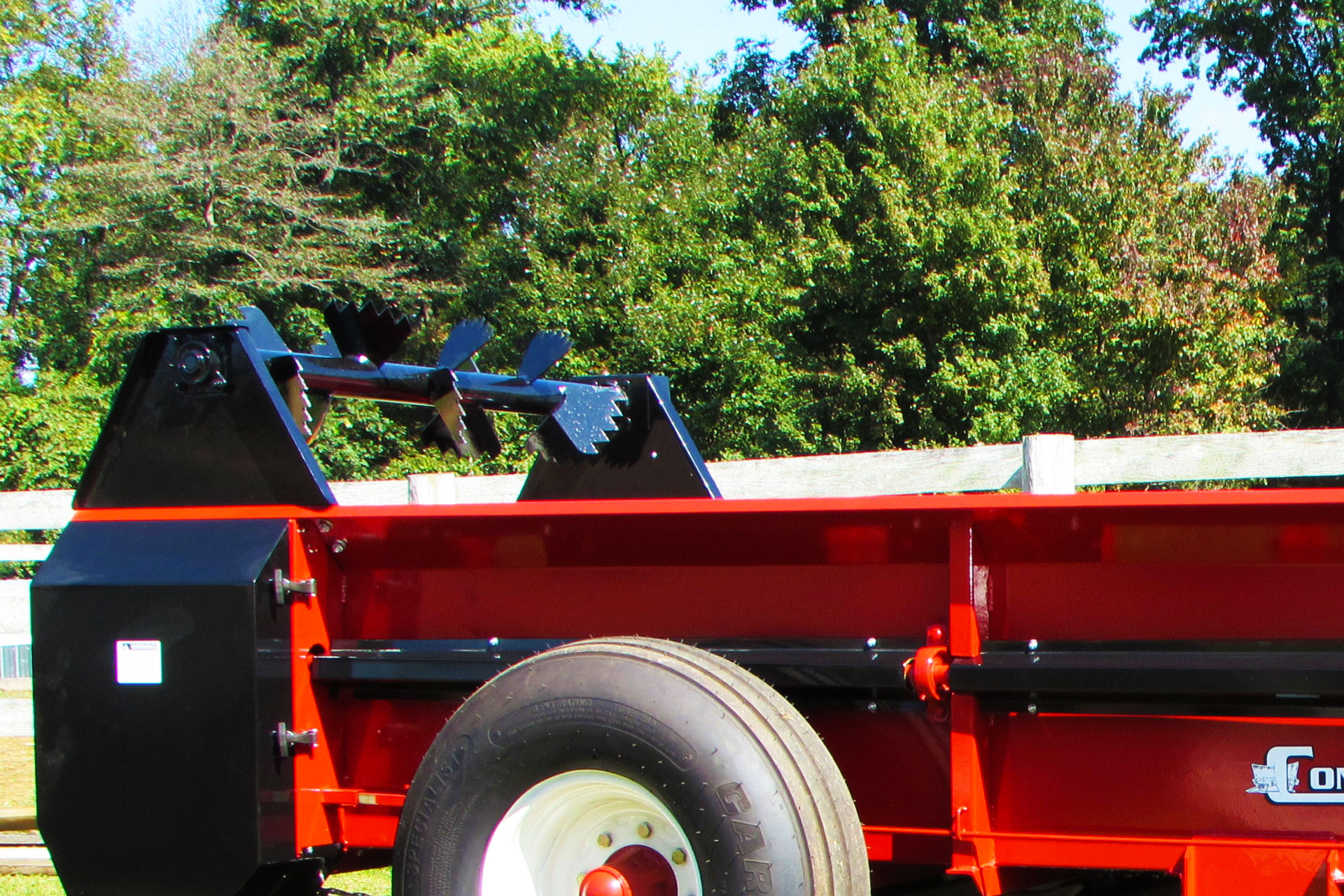 PTO tow behind manure spreader with optional top beater.