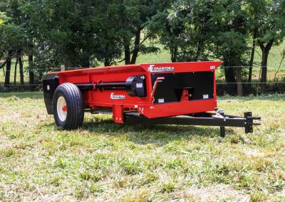 PTO tow behind manure spreader with 125 cubic feet of heaped capacity.