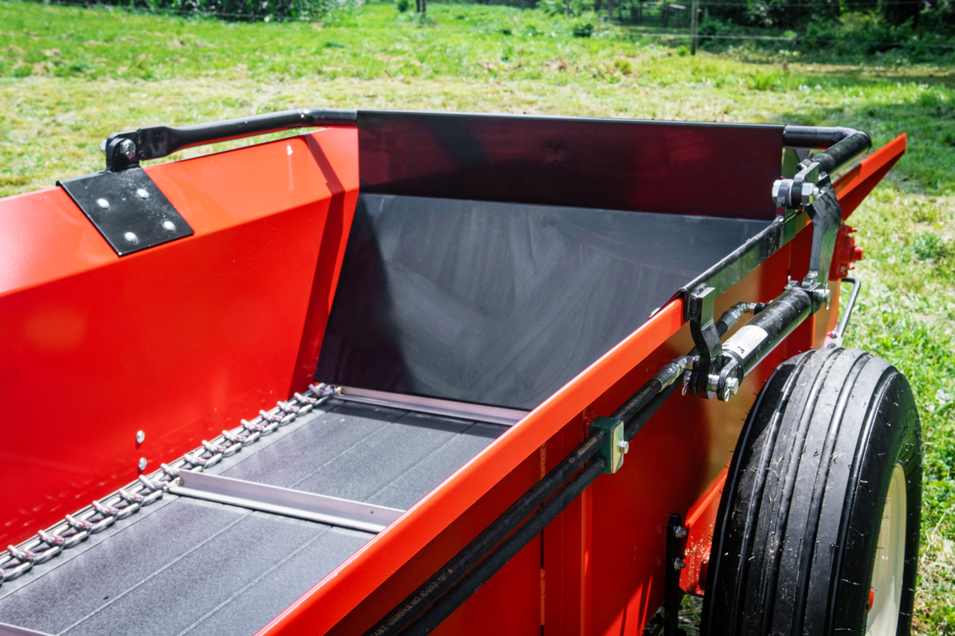 Large PTO farm manure spreader with optional hydraulic end gate from conestoga manufacturing.