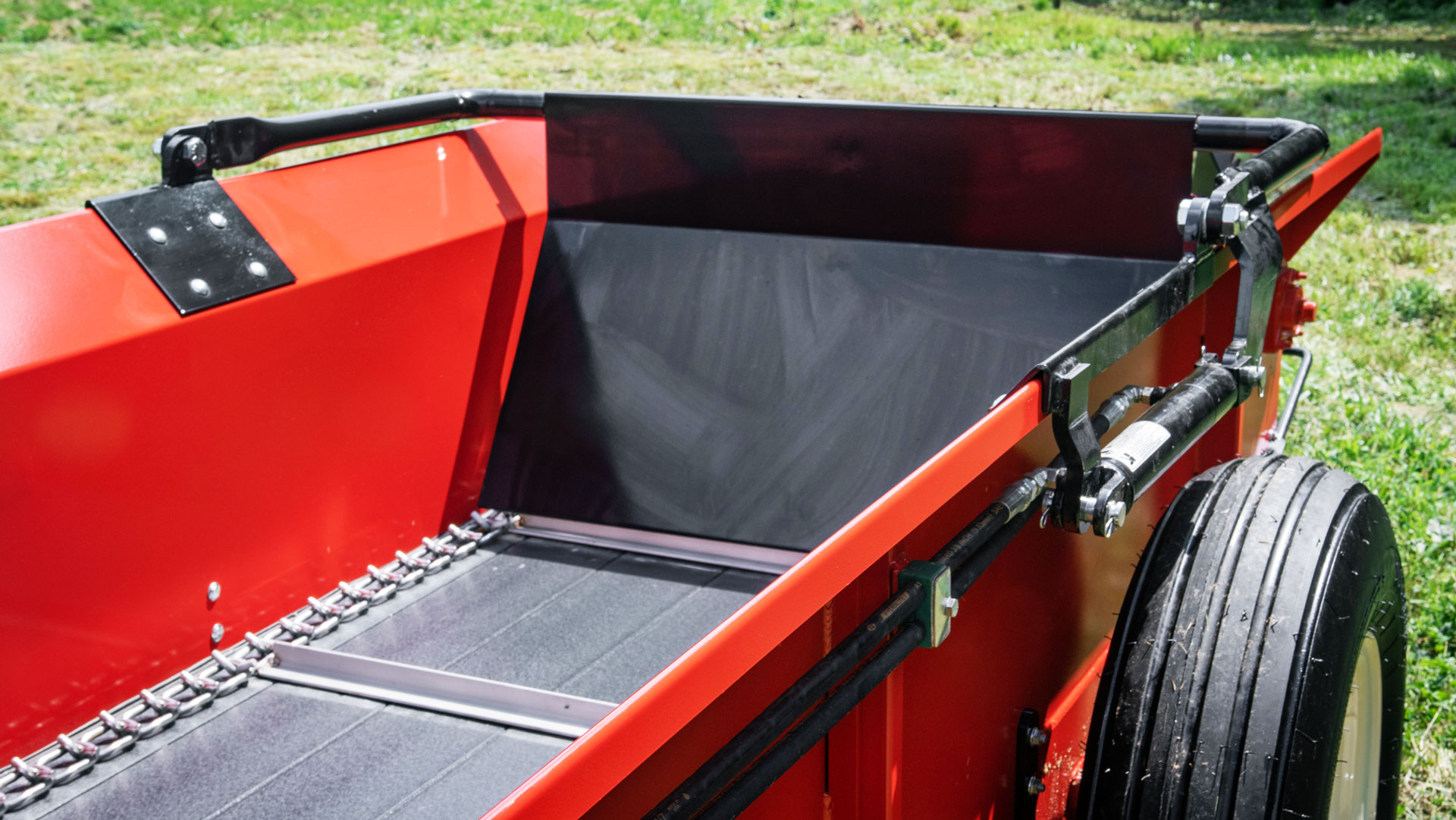PTO manure spreader by conestoga manufacturing with hydraulic endgate.