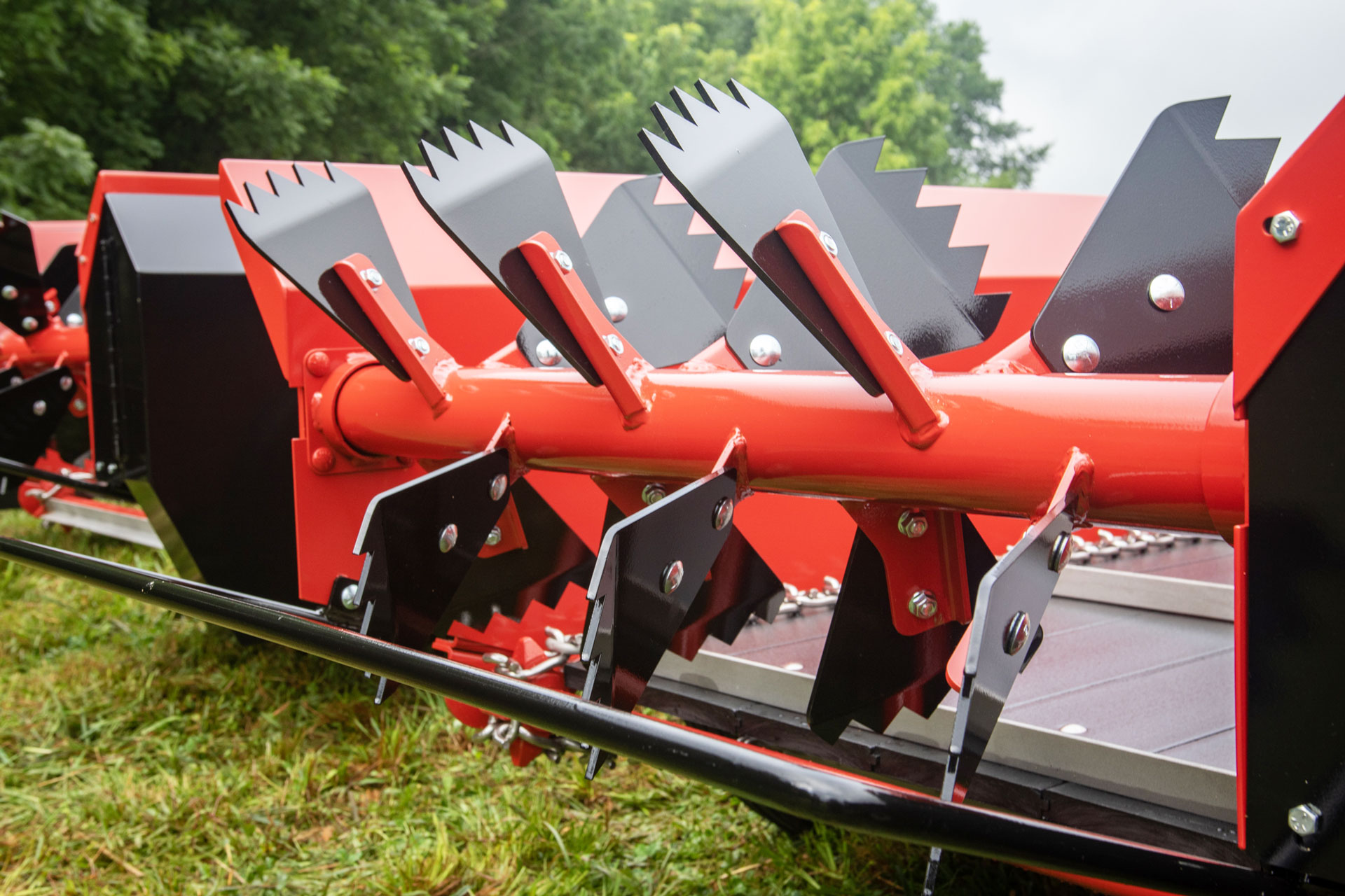 PTO manure spreader by conestoga manure spreaders with 12 rooster comb paddles.