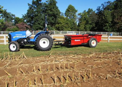 PTO horse manure spreader connected to a compact tractor.a manure spreaders 13